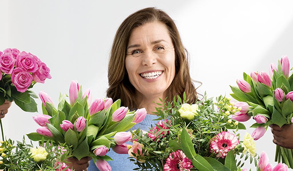 Feir mamma med blomster på morsdagen